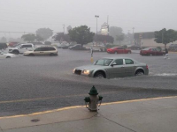 Photo of flash flooding in a parking lot